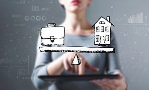 Image of woman with a graphic balancing a briefcase and a home in front of her.